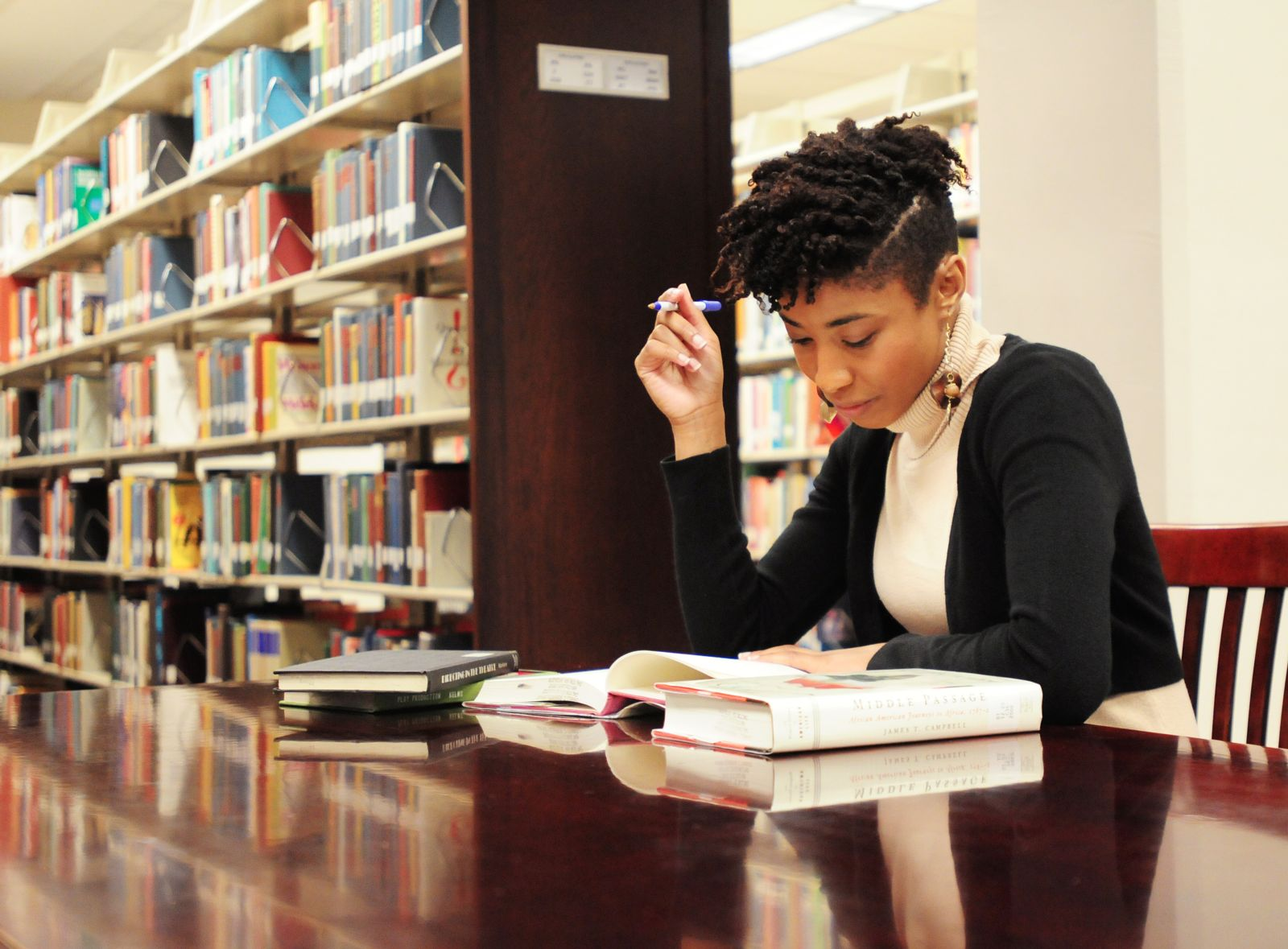 Photo of female student studying in Roberts Library