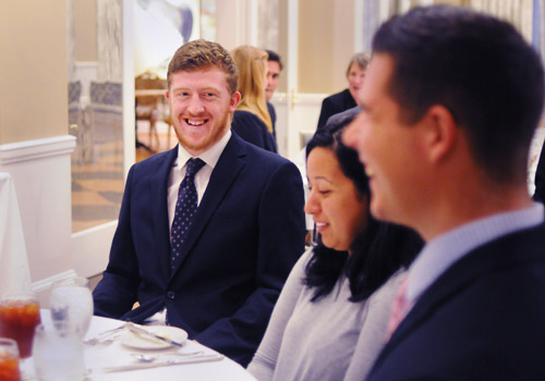 Photo of student smiling at business etiquette banquet